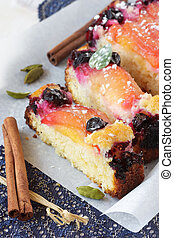 Fruitcake. - Fruitcake with red plums, a blueberry and...