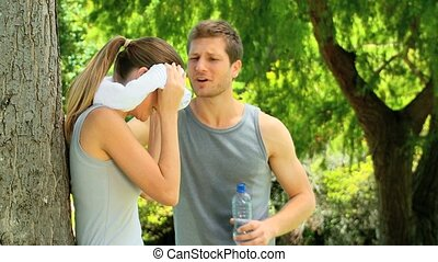 Cute couple after sports - Cute couple drinking water after...