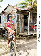 Nicaragua mother daughter bicycle poverty house Corn Island...