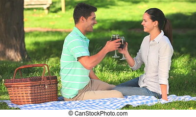 Lovers drinking red wine outdoors - Lovers laughing and...