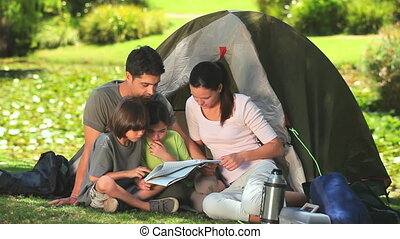 Family camping in the country side