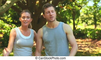 Couple taking a break while jogging - Couple discussing the...