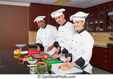 professional chefs cooking - group of professional chefs...