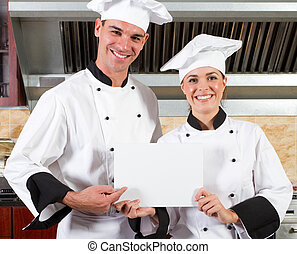 professional chefs with whiteboard - happy professional...