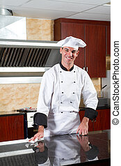 professional chef cleaning kitchen - young male professional...