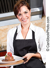 female waitress presenting dessert