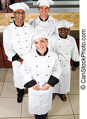 happy chefs - happy group of professional chefs in...