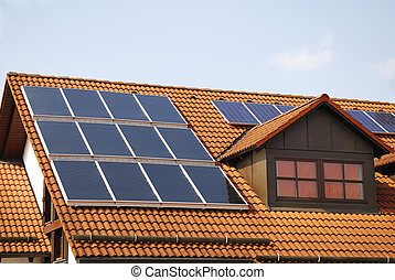 Green energy - House roof with a photovoltaic system