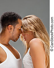 Salsa dancers, blonde caucasian woman and black man
