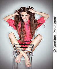 Screaming aggressive emotion woman in pink blouse with long hairs, ring flash studio portrait on white