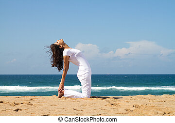 workout on beach - young woman doing exercise workout on...
