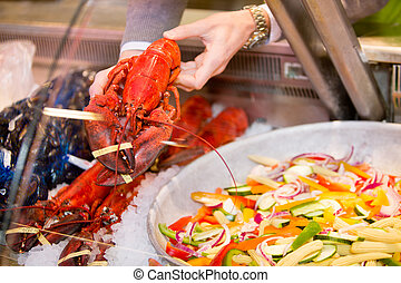 Lobster - A lobster for a sale at a fresh seafood counter in...