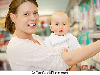 Baby and Mother in Grocery Store - A happy baby and mother...