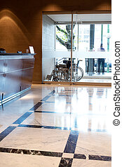 Hospital Inteior - An hospital entry with wheel chair and...