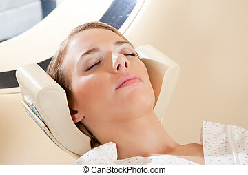 CT Scan Detail - A relaxed woman with eyes closed ready for...