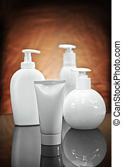 three white cosmetical sprays and tube