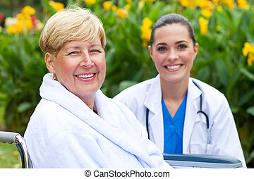 senior patient and young doctor - friendly doctor and senior...