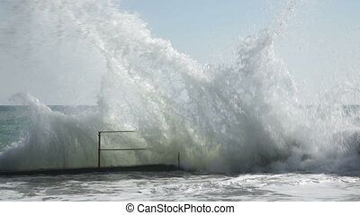 Seafront and pier with huge waves - Embankment and pier with...