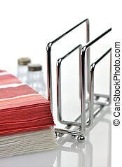Paper napkins and holder on white background