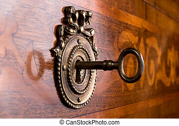 old key in keyhole - wooden drawer with metallic onlay and...