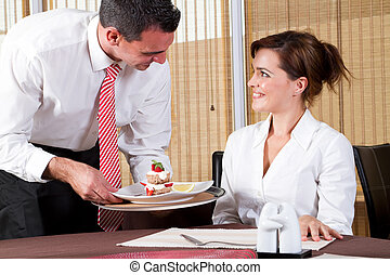 friendly waiter and customer - friendly male waiter brings...
