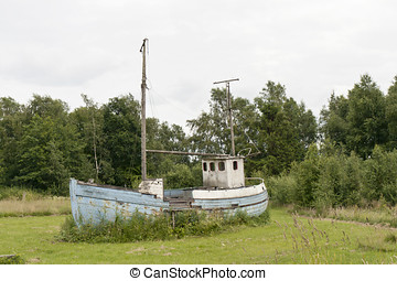 Obsolete Fishing Boat - Obsolete fishing boat in a...