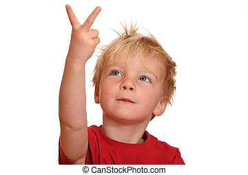 Young boy - A cute little boy points with his fingers upward