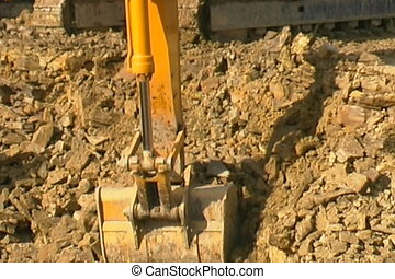 Excavator in a quarry. - Excavator at construction site.