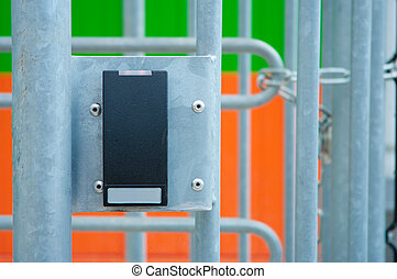 card access tool placed on a fence