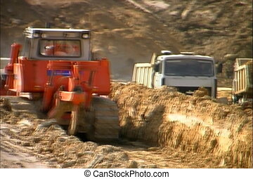 Dump truck in a quarry. - Excavator and truck at...