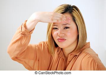 Asian girl headache or stress