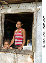 Nicaragua mother daughter smiling poverty house Corn Island...