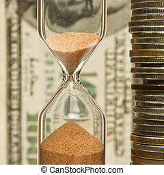 Time-money,hourglass and money - Time - money, hourglass on...