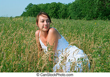 girl in white dress in field
