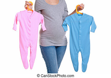 Pregnant woman holding baby clothes. - Photo of an...