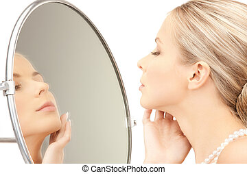 beautiful woman with pearl beads and mirror - picture of...