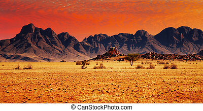 Rocks of Namib Desert - Colorful sunset in Namib Desert,...