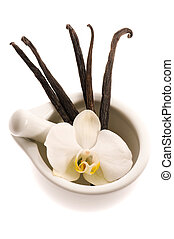 mortar with vanilla pods and flower
