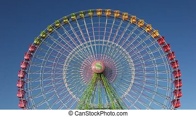 Ferris wheel - Colorful ferris wheel against blue sky