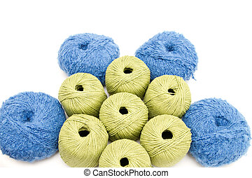the green and blue yarn skeins isolated on white