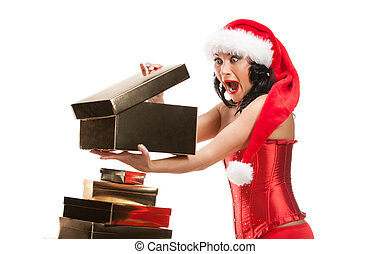 Beautiful christmas woman in santa hat  with fancy box