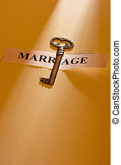 Key to Marriage - A key laying on a piece of paper with the...