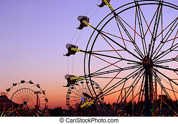 Carnival Silhouettes - Silhouettes of carnival rides under...