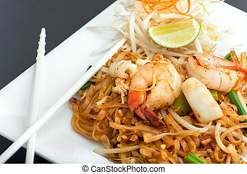 Seafood Pad Thai Fried Rice Noodles - Seafood pad Thai dish...