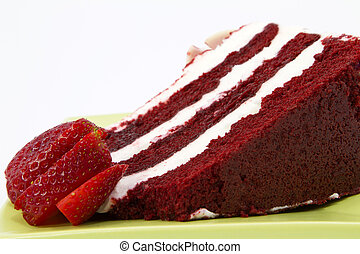 Red Velvet Cake Garnished with Strawberries - A slice of red...