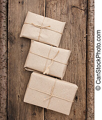 pile parcel wrapped with brown kraft paper and tied with...