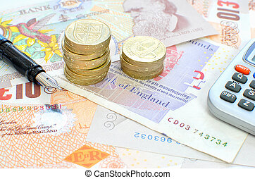 Personal finances - Sterling bank notes and a fountain pen