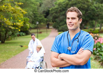 young male doctor portrait - friendly young male doctor...