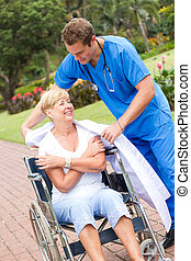 caring doctor or nurse giving his jacket to a senior patient