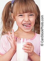 Girl with milk - Cute little girl with glass of milk on...